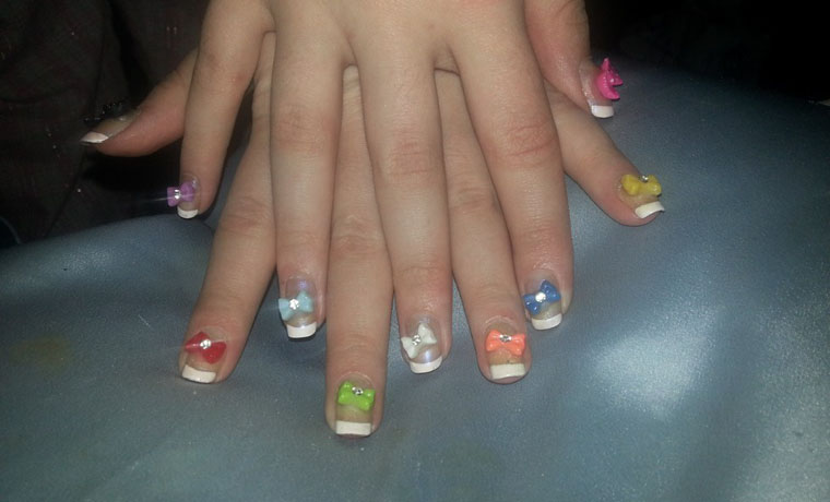 Multi-Coloured Bows Nail Art